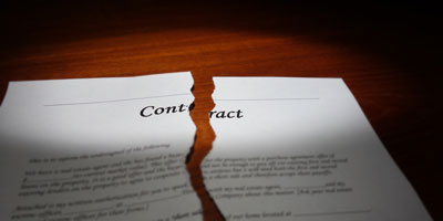 A contract torn in two pieces.