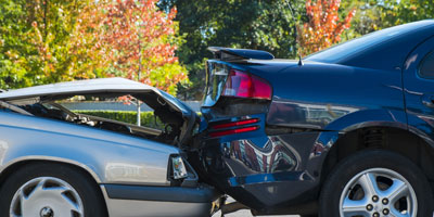 Two cars after a rear end collision.